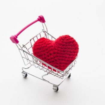 high-angle-shopping-cart-with-valentines-day-ornament_23-2148382694