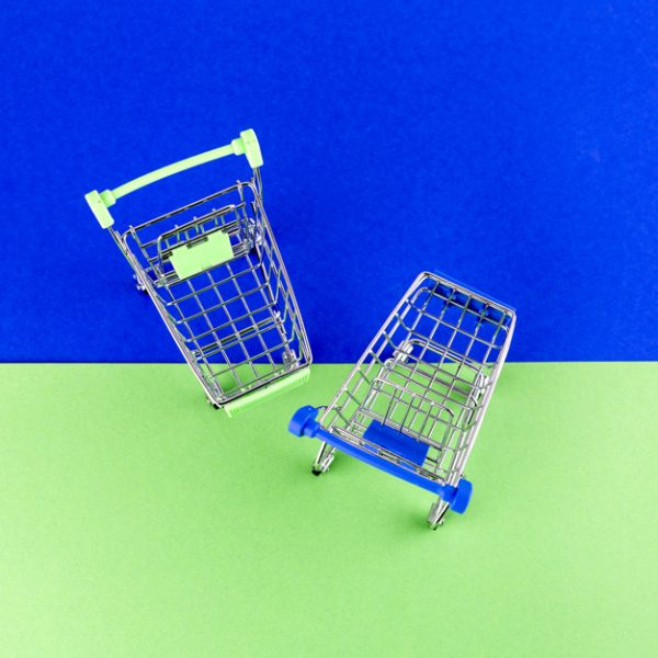 overhead-view-two-shopping-carts-blue-green-background_23-2147968536