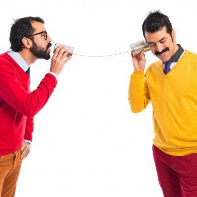 twin-brothers-talking-through-tin-phone_1368-3183